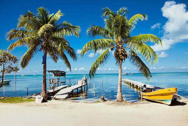 Belize tours to beachside docks with boat.
